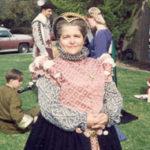 A full body photo of Mistress Louise, wearing Elizabethan style clothing.